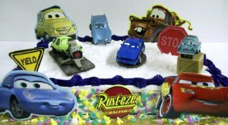 Disney Pixar Cars 2 11 Piece Cake Topper Featuring Professor Z, Acer, Finn McMissile, And Rod Redline. Also Includes Decorative Cars 2 Cake Pieces Featuring Lightning McQueen, Sally, Luigi, Mater, Red Ramone, 1 Yield Sign, 1 Stop Sign, and Rust eze Racing
