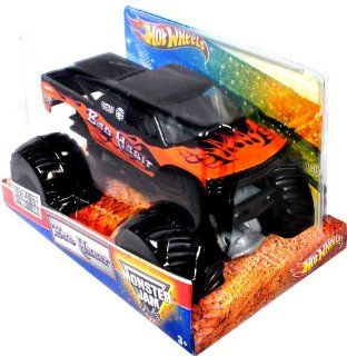 """Hot Wheels Monster Jam 124 Scale Die Cast Metal Body Official Monster Truck 2011 Series #T8523   Joe Sylvester BAD HABIT with Monster Tires, Working Suspension and 4 Wheel Steering (Dimension  7"""" L x 5 1/2"""" W x 4 1/2"""" H) Toys & Games"""